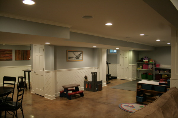"Basement Remodel, Once an ugly basement with bright red carpet and drop ceiling becomes a cool space for kids, theater, poker, exercise, and more. Note the stained concrete floor and louvered <a href=""http://www.shutterland.net"">exterior shutters</a> are used as doors., Basement After: kids play area, exercise area, painted walls, repainted wainscoting.   , Basements Design"