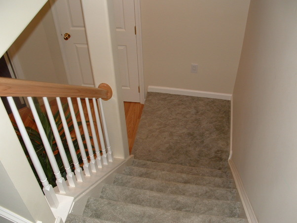 Did it myself, Finished my basement - from plain concrete walls to a space designed by me that is open, has an office, powder room, TV area, kids area, refreshment area and storage., finished view down the steps and powder room door.   , Basements Design