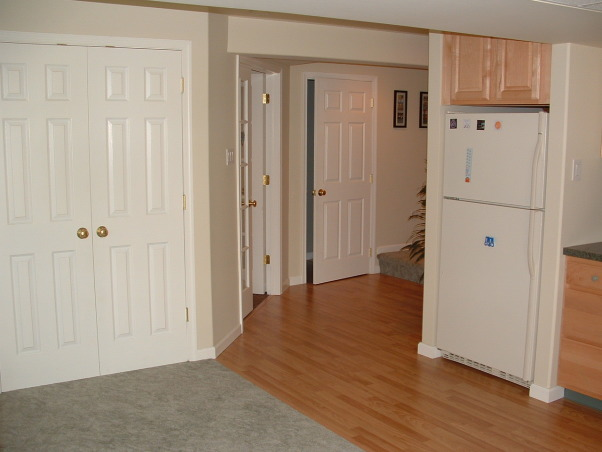 Did it myself, Finished my basement - from plain concrete walls to a space designed by me that is open, has an office, powder room, TV area, kids area, refreshment area and storage., wider view of stairs, powder room door office area, closet and fridge.  fridge is actually tucked under stairs.  Many people put closets in this space.   , Basements Design