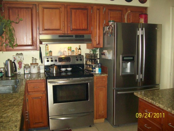 love my kitchen hate the floor, I remodeled this kitchen with my husband, I refinished the cabinets, he built the island and tiled the floor (which I hate, don't tile while drinking beer), and we hired someone to install the granite counter tops. , Kitchens Design