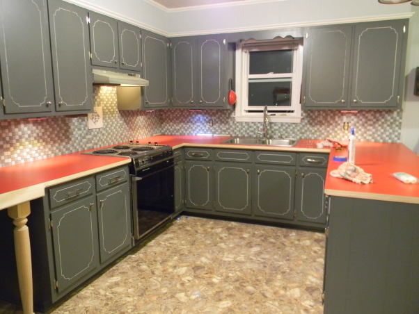 Avocado Green is Gone!!!, We went from a 1975 to 2012 Kitchen, One step closer to being done.  We installed the red laminate countertop and the edge trim.  Installed the backsplash but still have to paint the vent hood. , Kitchens Design