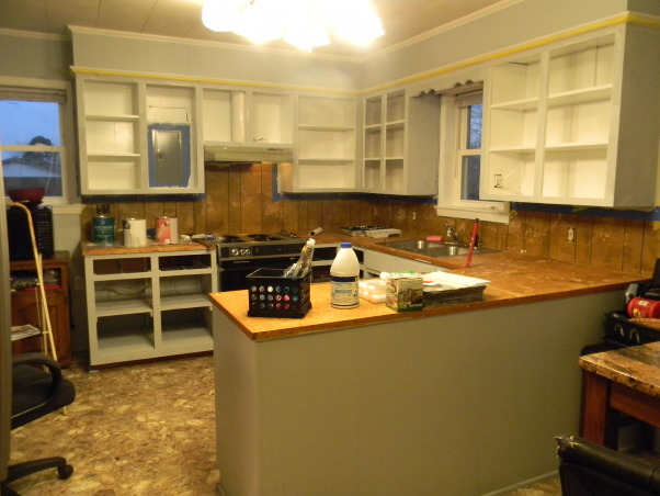 Avocado Green is Gone!!!, We went from a 1975 to 2012 Kitchen, First we painted the brown paneling light gray.  Then painted the inside of the cabinets white.   , Kitchens Design