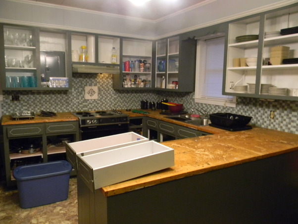 Avocado Green is Gone!!!, We went from a 1975 to 2012 Kitchen, We painted the cabinets dark gray and notice the avocado green counter tops are gone and we tiled the back splash.  The vent hood over the stove is still green but spray paint is wonderful.   , Kitchens Design
