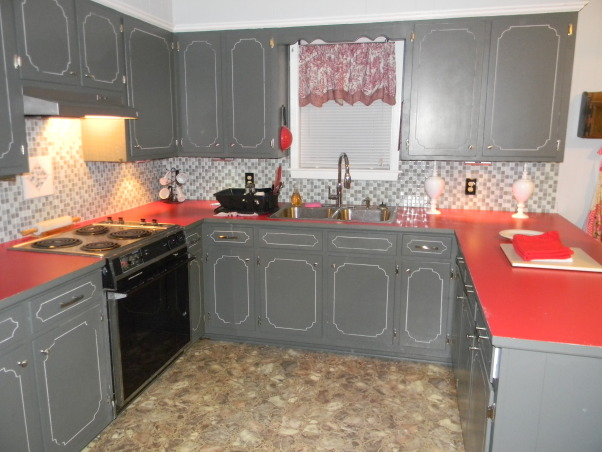 Avocado Green is Gone!!!, We went from a 1975 to 2012 Kitchen, Almost finished.  Still have to grout the backsplash under the window.  The countertops are red laminate.  We kept the sink and stove but installed new kitchen facets.  Stove still works good and we were on a tight budget.  So for about $600.00 my daughter has an almost new kitchen.   , Kitchens Design