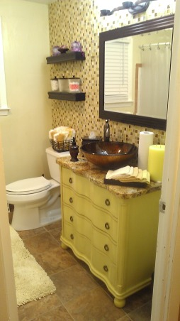 Sunshine room, Remodoled bath with Bronze and Gold glass tile back splash, glass vessel sink set on top of Amber granite postioned on yellow vanity with a Bronze faucet and ceramic floor tile., Bathrooms Design