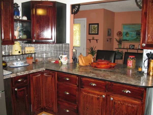 remodel from small 4 cabinet kitchen, Our kitchen had 4 cabinets originally stove sink and frig. We knocked a hole in the dining room wall to add a serve thru counter and bar., dining room wall with window and new bar, Kitchens Design