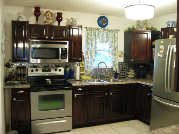 remodel from small 4 cabinet kitchen, Our kitchen had 4 cabinets originally stove sink and frig. We knocked a hole in the dining room wall to add a serve thru counter and bar., this is the after , Kitchens Design