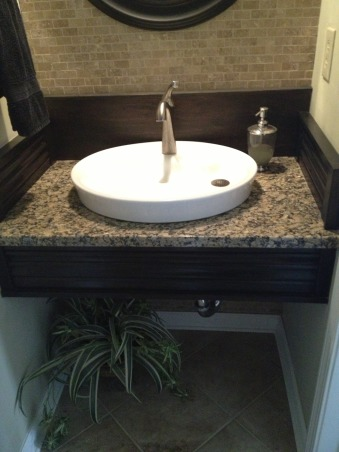 Small powder room makeover, 3x6 powder room renovated on a budget.  Repurposed backsplash and floating vanity skirt.  Total cost under $800., Here's how I do it on a budget.  Sink $27 auction find, vanity skirt and backsplash is repurposed from window or door trim (not sure which)  from an old house found at a salvage store for $10.  Granite is a remnant., Bathrooms Design