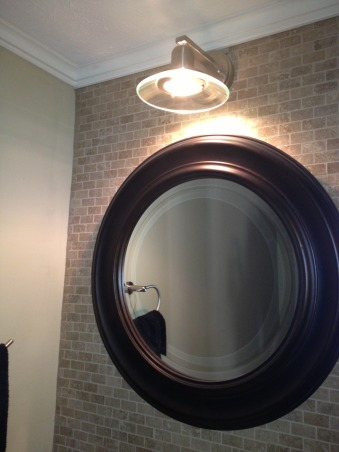 Small powder room makeover, 3x6 powder room renovated on a budget.  Repurposed backsplash and floating vanity skirt.  Total cost under $800., Mirror $49 at Target and light $39 at Lowes.  Total tile cost for wall and floor under $100., Bathrooms Design