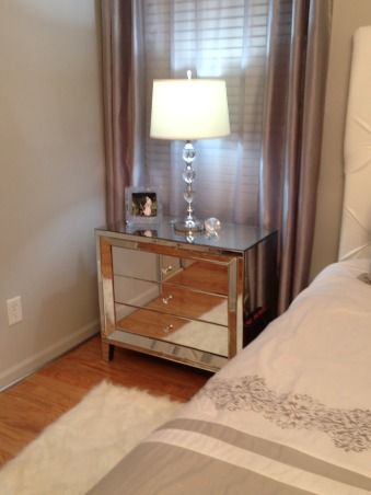 Grey Master, White leather tufted headboard, mirrored nightstands, crystal chandelier, silver metallic trim, crystal lamps with white drum shades..., Bedrooms Design