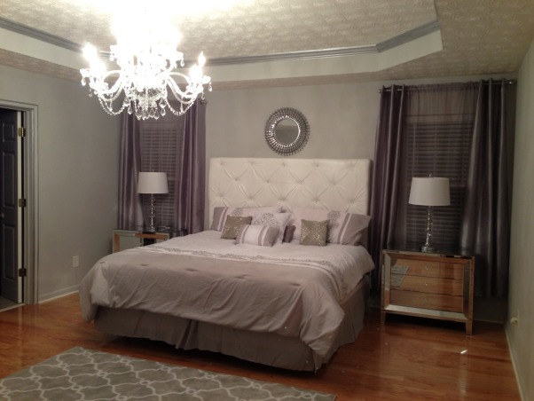 Grey Master, White leather tufted headboard, mirrored nightstands, crystal chandelier, silver metallic trim, crystal lamps with white drum shades..., Full view   , Bedrooms Design