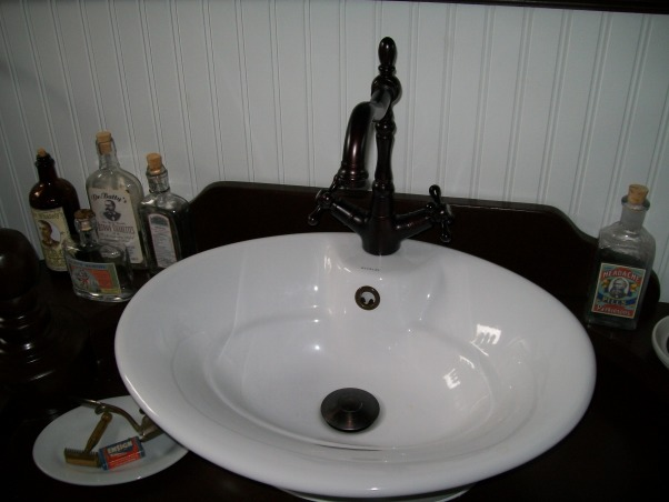 1920's Retreat., Went back in time from a 1970's bathroom to a 1920's style., Vessel sing with deco faucet. , Bathrooms Design