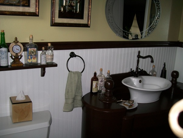1920's Retreat., Went back in time from a 1970's bathroom to a 1920's style., Etched mirror over sink. , Bathrooms Design