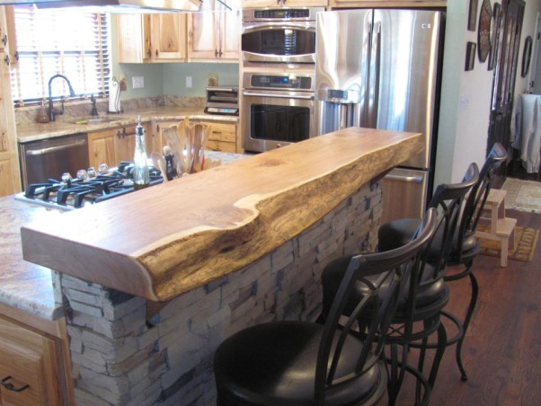 Colorado Kitchen, moved to home last year and wanted more functional kitchen, I love to cook.  This is our retirement home and we have embraced the rustic, western look for our new space., rough finished elm slab breakfast bar. The other half is the mantle.       , Kitchens Design