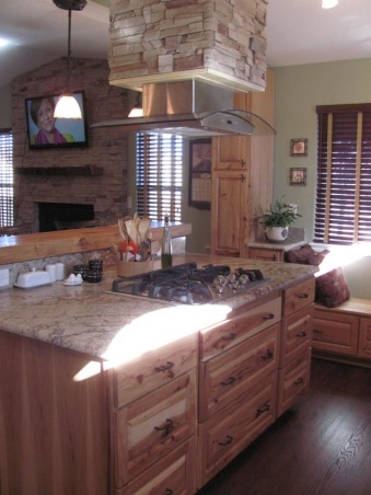 Colorado Kitchen, moved to home last year and wanted more functional kitchen, I love to cook.  This is our retirement home and we have embraced the rustic, western look for our new space., View of the fireplace and the vent chimney.         , Kitchens Design