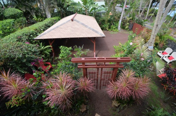 Bali House and Bali Cottage Hawaii, Bali and Asian Inspired tropical gardens in Hawaii., Japanese Tori gate, tropical landscaping with red lava rock paths, Gardens Design