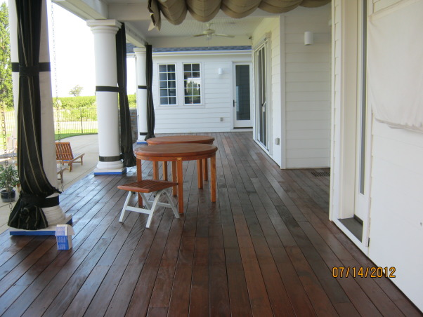 Deck Restoration,  How to restore an old deck to look beautiful again., After the deck is completely dry, a good sealer is needed. Here a penetrating oil is used, you should always be sure to rub the oil into the wood, not leaving any excess on the wood's surface. , Patios & Decks Design