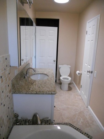 DIY-small/narrow bathroom, not complete yet, new light fixture/vanity/toilet + skylight adds more natural light, not done yet, behind the door is incomplete shower , Bathrooms Design