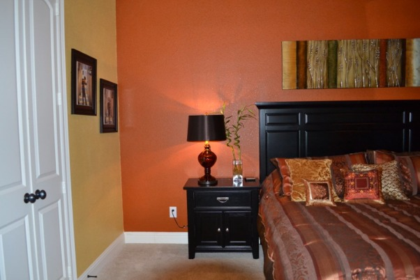 bold master bedroom the colors are a deeper burnt orange and a gold