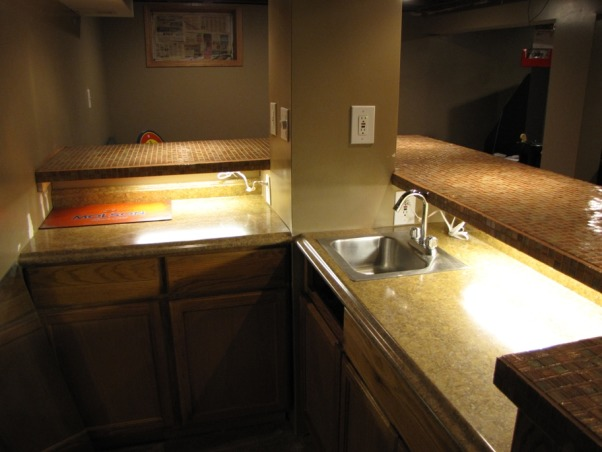 Basement Stair Replacement, Replaced existing basement stairs with completely custom hardwood stairs., under counter lighting behind bar, Basements Design