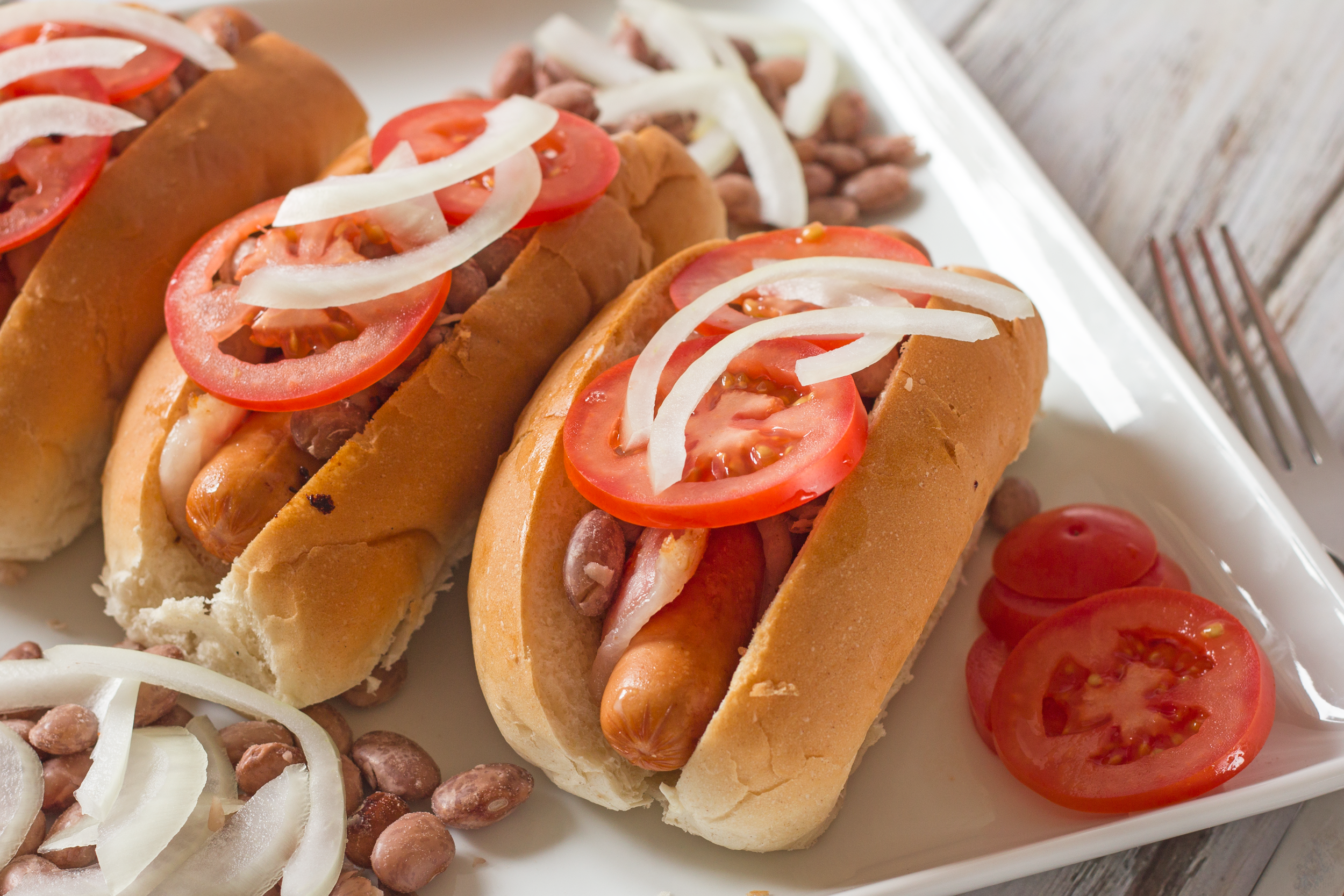 The hot dog is one of those foods that's nearly impossible to mess up. You heat it through, plop it on a bun, squirt on some mustard, and call it lunch.