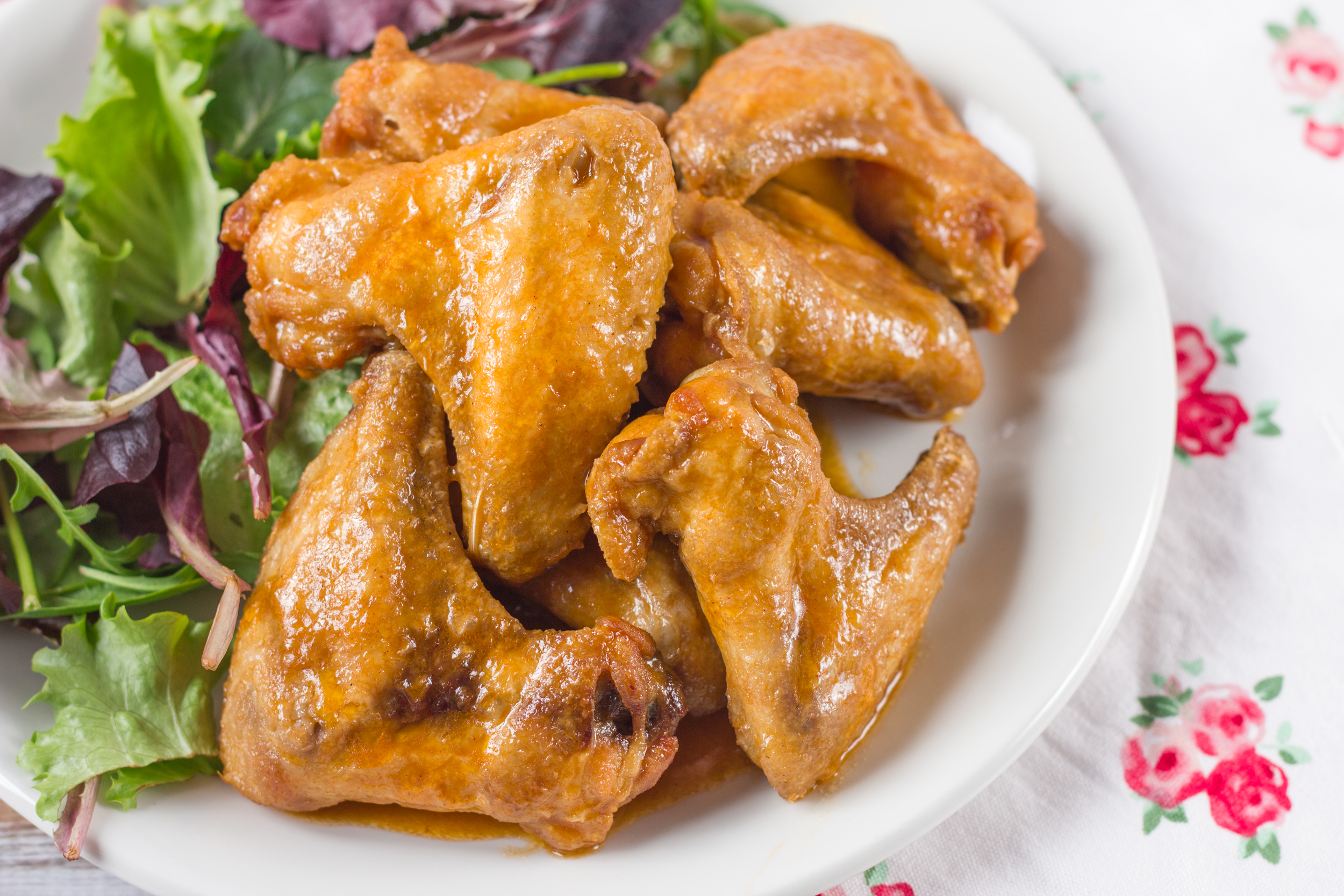Fly high with our blistering buffalo wings. If you have a hankering for spicy foods, these piping hot wings are sure to quell you cravings. Don't be a chicken -- give them a try tonight. Dump a 5 lb. bag of frozen wings into a big pan (like a roaster or lasagna pan), add half a lb. of butter and a.