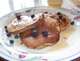 Banana Pecan Pancakes Served With Berries. Photo by WiGal