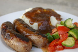 Brats With Beer Gravy -- Man Fuel. Photo by Lazarus