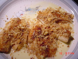 Tilapia... White Chocolate Macadamia Crusted Tilapia. Photo by Timothy J Higgins Eva
