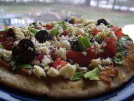 Pita Pizzas With Hummus, Spinach, Olives, Tomatoes & Cheese. Photo by LifeIsGood