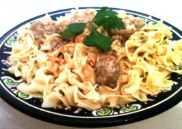 Swedish Meatballs in Sour Cream Sauce over Buttered Egg Noodles. Photo by The Spice Guru