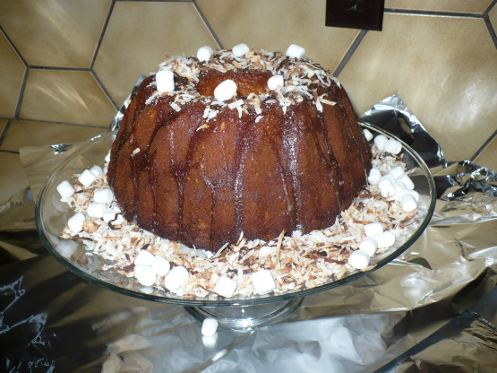 Coconut Sour Cream Bundt Cake With Sugar Icing And Marshmallows Recipe ...
