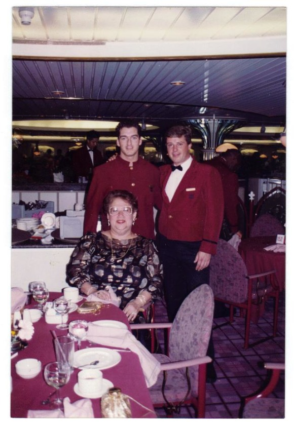 On my last cruise,seated with the waiter and helpers, This photo has the maitre'd of the ship,and two of his hlpers during our International Night,this one was the French celebration night,in which we were given delicious meals with French delicacies, after,we were served cheeses and wine just like your photo shows,and to finish,we had chocolate cake with gnache and mousse,it was a perfect French celebration!