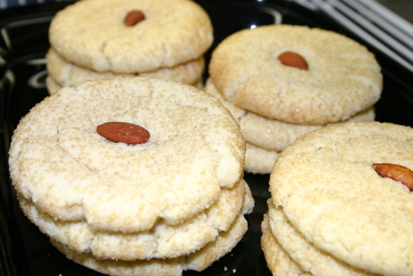 Almond Ginger Sugar Cookies, A wonderful almond flavored sugar cookie rolled in raw sugar and topped with a roasted salted almond.