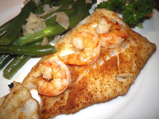 Low fat cajun style fish in parchment delish recipe for Cajun fish recipes