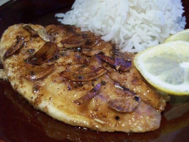 Sauted fish fillets with sliced garlic and butter sauce for Garlic sauce for fish