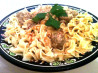 Swedish Meatballs in Sour Cream Sauce over Buttered Egg Noodles. Recipe by The Spice Guru