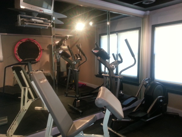 home gym, This is the second room finished out in the basement. this P90x inspired room has a mirrored wall and rubber flooring, finished gym with equipment, Other Spaces Design