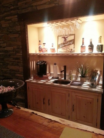 Warm and Cozy in a big space, We just recently finished our basement.  It was a very big and long space.  We wanted to create a warm, cabin like feeling and a space our soon to be teenage daughter could go to hang with friends., Just added our top shelf :), Basements Design