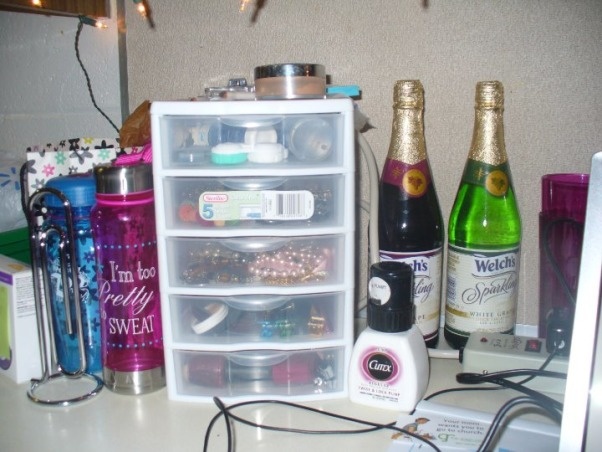 Jess' Vibrant Dorm Room, Jessica's freshman dorm room - wanted to make it something different from all the other cookie cutter college dorms & tried to make the small space my own with the limitations & all. Happy with the end result., Water bottles, organized accessories & girly items, and my personal Welch's grape juice addiction., Dorm Rooms Design