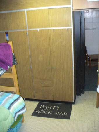 "Jess' Vibrant Dorm Room, Jessica's freshman dorm room - wanted to make it something different from all the other cookie cutter college dorms & tried to make the small space my own with the limitations & all. Happy with the end result., Boring closets, could've done more with them but atleast I got my ""Party Like A Rockstar"" rug. :), Dorm Rooms Design"