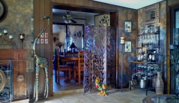 Living rooms , Solar powered home. Sonoran Desert, AZ., Solar Green Home. Sun powered, Earth friendly., Wine rack space with stain glass panels and Mexican art work, Living Rooms Design