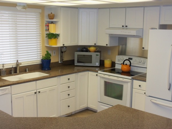 my spot of orange, My kitchen is decorated in white, with a brown crushed granite countertop., My clutter free counter tops are possible with plenty of smooth surfaces for easy wiping., Kitchens Design