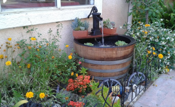 Small Garden Space, I had an area outside of my kitchen window that needed a face lift. Using salvaged pieces such as an old wine barrel and old shutters, I created a calm garden and water feature in a small space., I found an old wine barrel and went on line and found a manufacture of plastic wine barrel liners. I cut a piece of plywood with a jig saw and painted it with a water sealer.  I found the pump on ebay too and ran a fountain pump hose up through the plywood and the pump. I love the effect., Gardens Design