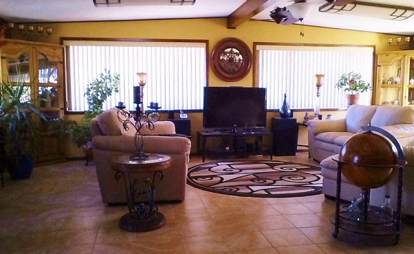 Living rooms , Solar powered home. Sonoran Desert, AZ., Solar Green Home. Sun powered, Earth friendly., Great room/living room center. Earth tones. Softened out large very square room and corners with rounded and curved objects. Marazzi  porcelain tile floor, Living Rooms Design