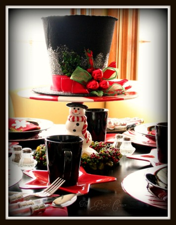 Christmas Top Hat Tablescape, This tables inspiration was the Tophat decoration that I found at my grocery store. most of the dishes were very budget friendly. The chargers I found last year after Christmas for $1 at the Christmastree Shop. The black dishes are afrom a set I bought at a Dollar store for $10. The star plates are plastic & along with the iceskate felt bags, which are giftcard holders, came from my local grocery store., Kitchens Design
