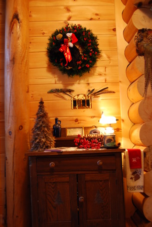 Log Home Christmas Tour, Welcome! Come on in and let me take your coat (hugs)! Would you like a cup of hot cocoa or coffee? Let's step into the great room by the fire and catch up with each other! Merry Christmas!, The quilt wall hanging that usually hangs over the hallway wash stand gets replaced during the holidays with a woodland wreath with a black bear hanging in it. A few red berries added to the sugar pine cone on top of the wash stand adds a splash of red - everything else is there year-round.        , Holidays Design