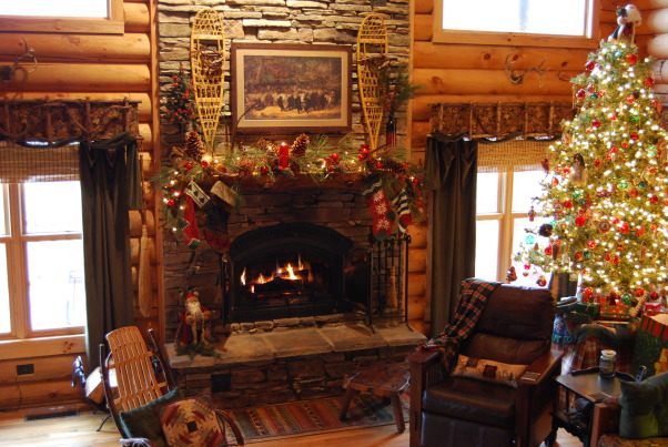 Log Home Christmas Tour, Welcome! Come on in and let me take your coat (hugs)! Would you like a cup of hot cocoa or coffee? Let's step into the great room by the fire and catch up with each other! Merry Christmas!, The stockings were hung by the chimney with care. Actually, there are 4 more stockings to be hung, but the fireplace gets too hot to hang them all right now. The tree is on a card table draped with plaid tablecloths, first to add height and secondly because I have WAY too much decorating to do to have to decorate a tall floor to ceiling tree by myself. It tires me just thinking about it. Today you can't see the tablecloth at all because all the gifts are stacked around it.          , Holidays Design