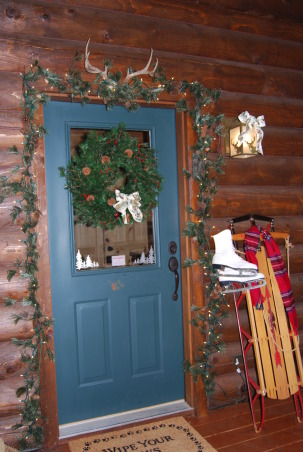 Log Home Christmas Tour, Welcome! Come on in and let me take your coat (hugs)! Would you like a cup of hot cocoa or coffee? Let's step into the great room by the fire and catch up with each other! Merry Christmas!, Mud room door entrance. This is the door that most of us use. The sled was my son's when he was a child - it usually hangs on a log wall in the dining room but it got to get outside for some fresh air this Christmastime.          , Holidays Design