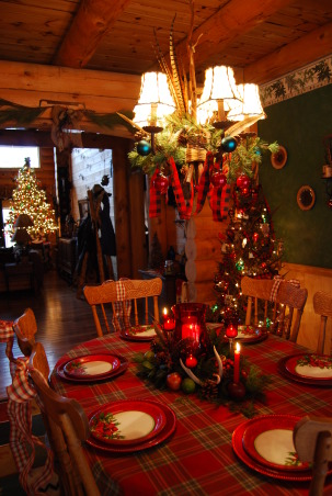 Log Home Christmas Tour, Welcome! Come on in and let me take your coat (hugs)! Would you like a cup of hot cocoa or coffee? Let's step into the great room by the fire and catch up with each other! Merry Christmas!, Dining Room view through arch to great room. The table centerpiece is handmade with fresh cut evergreens from the woods, fresh apples and limes, pine cones, feathers, and even apples used as candle holders as in more simpler times.          , Holidays Design